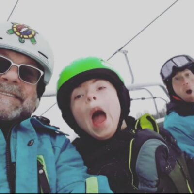 A man on a monoski smiling for the camera.